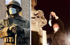 Mascherina sul monumento ai caduti, Torchio la toglie